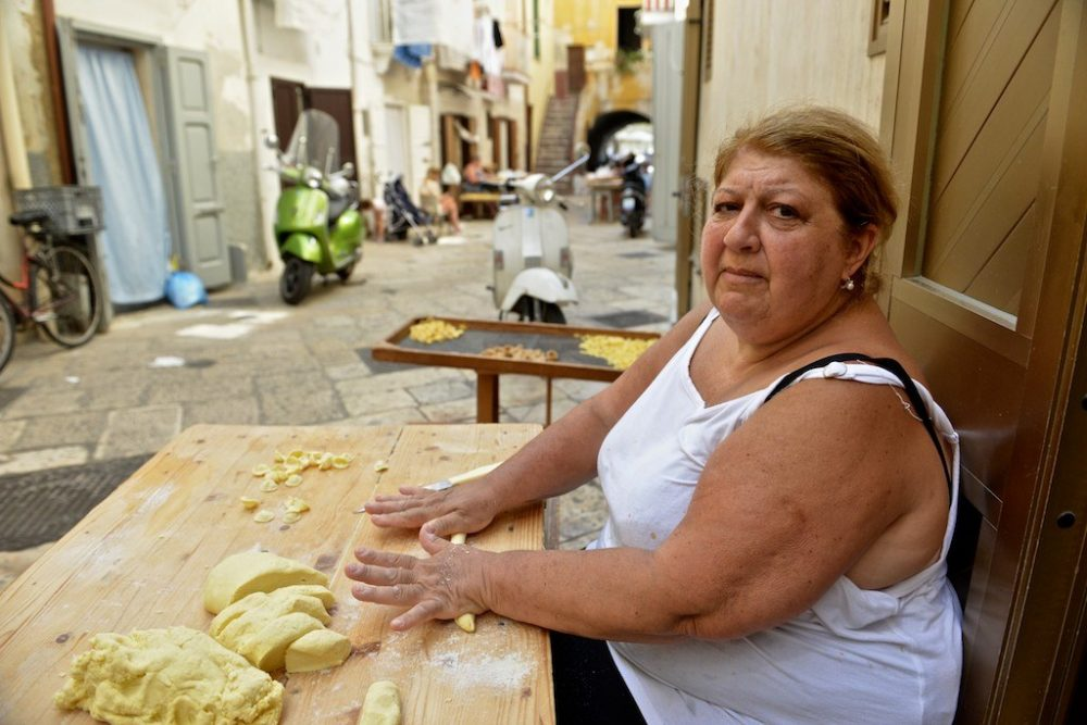 In Bari, pasta is made streetside with just semolina flour and water.