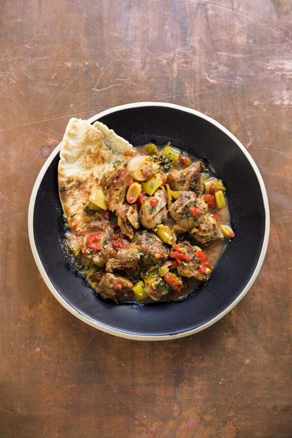 Spicy Pork with Leeks and Roasted Red Peppers (Tigania)