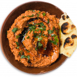 Muhammara gets its rich color from roasted red peppers.
